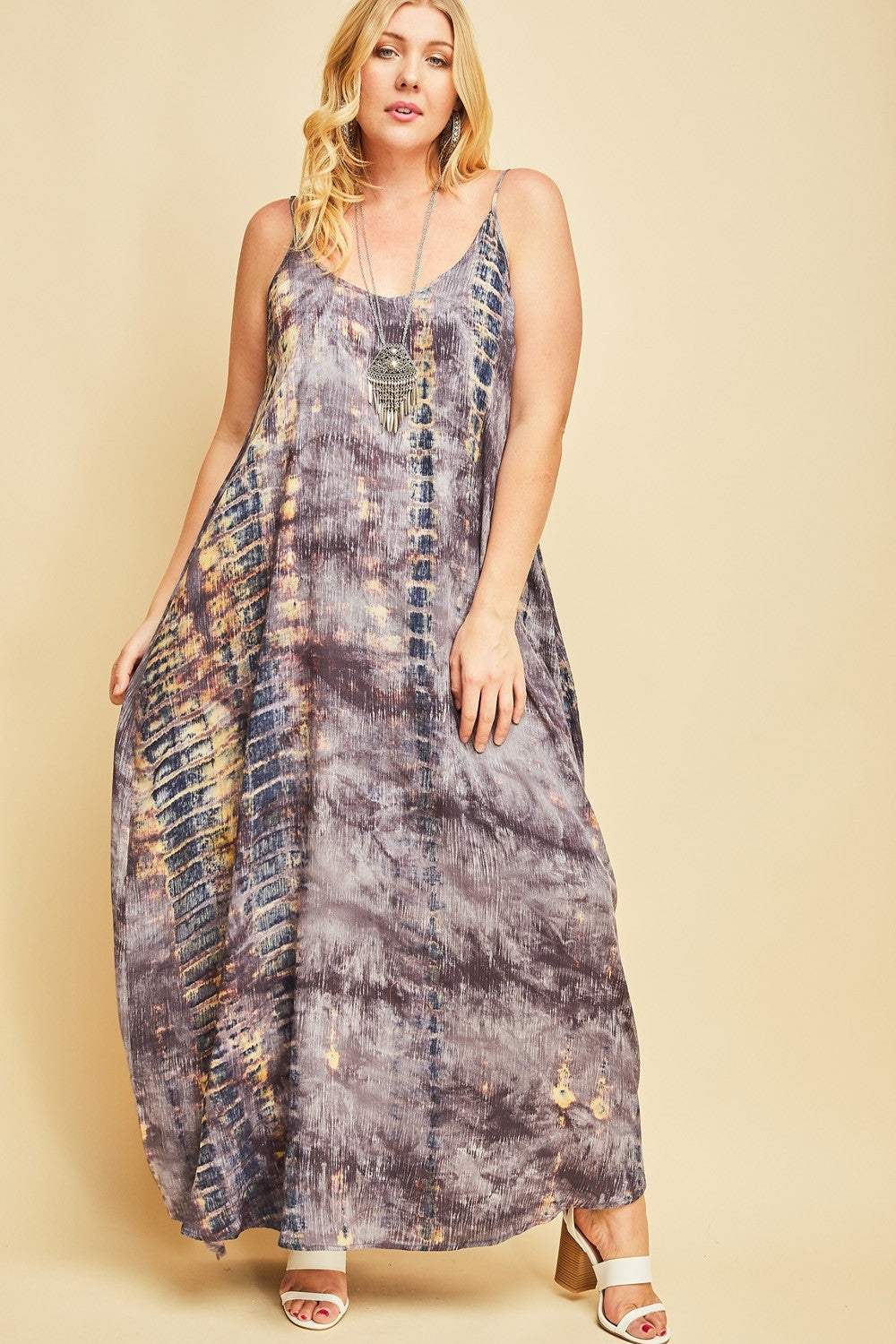 Front view plus size woman wearing sleeveless slate blue multi maxi dress with side pockets