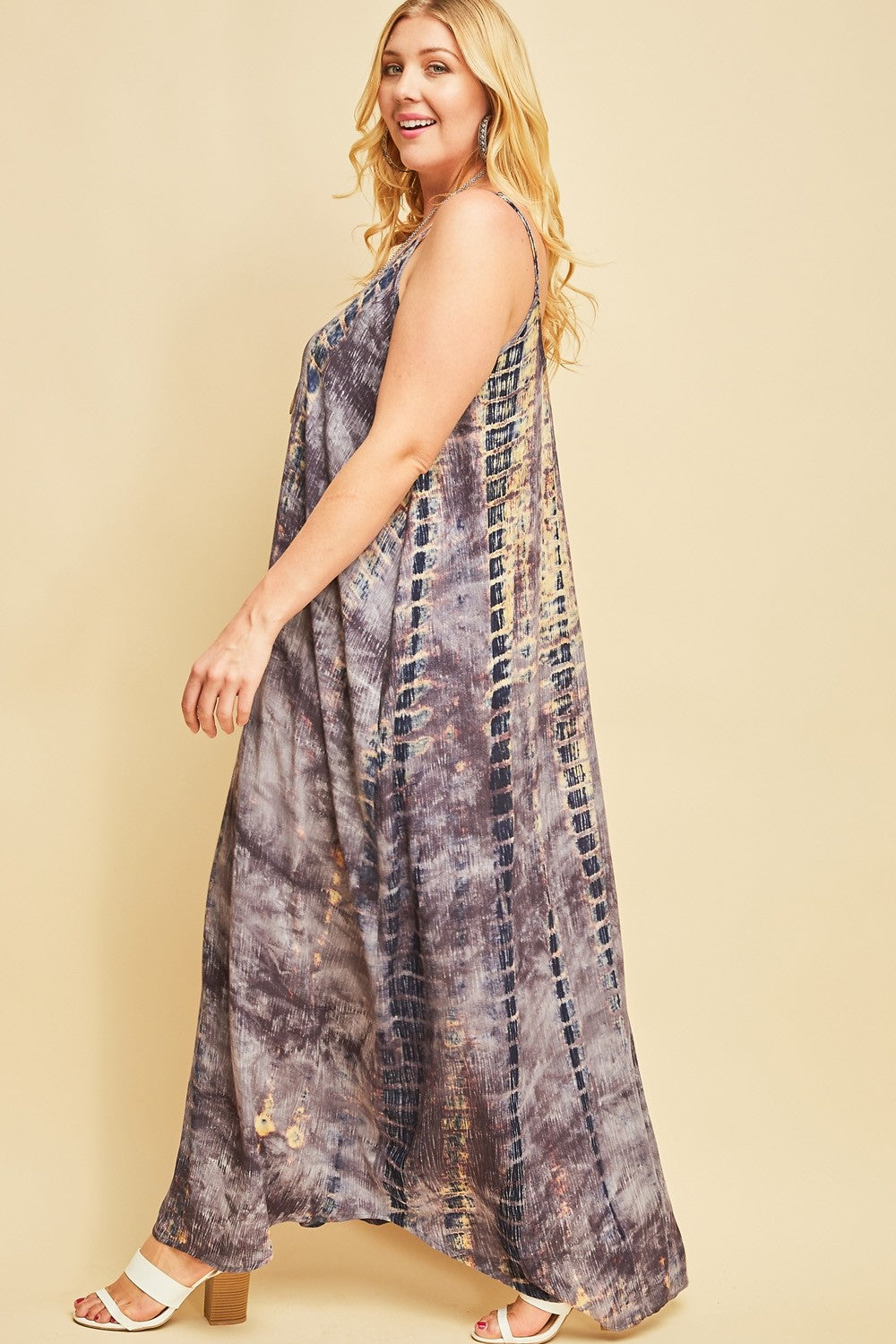 Side view plus size woman wearing sleeveless slate blue multi maxi dress with side pockets