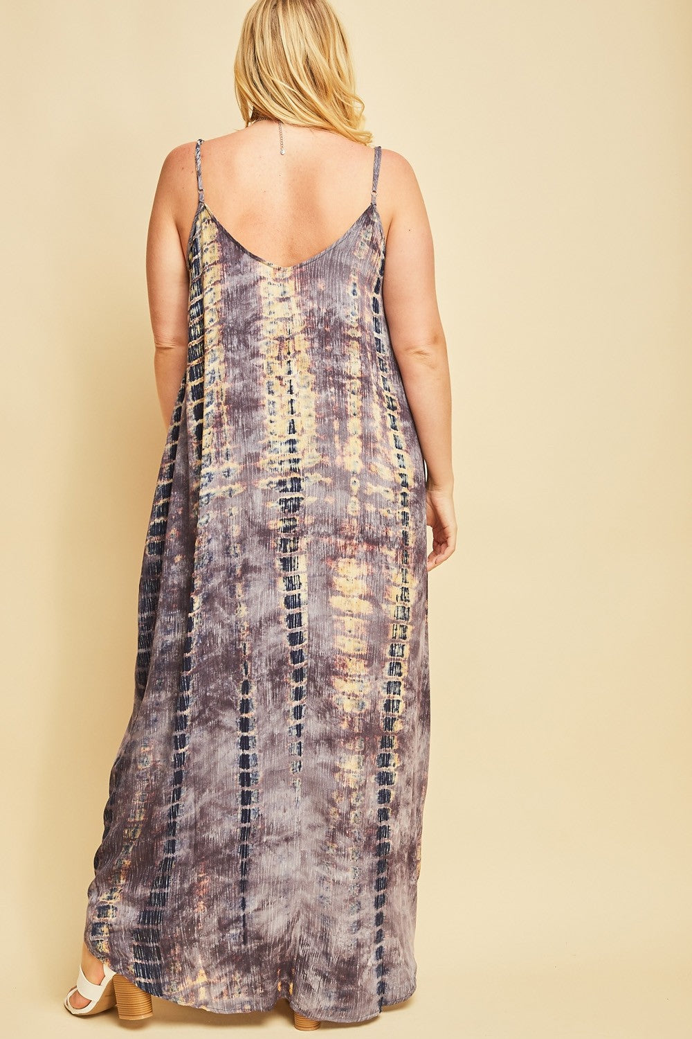 Back size woman wearing sleeveless slate blue multi maxi dress with side pockets
