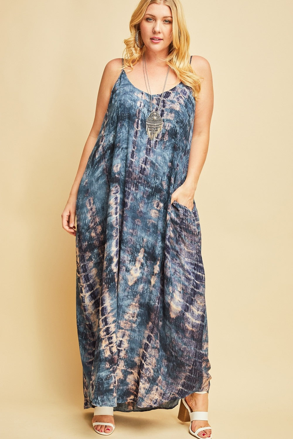 Front view plus size woman wearing sleeveless teal multi maxi dress with side pockets