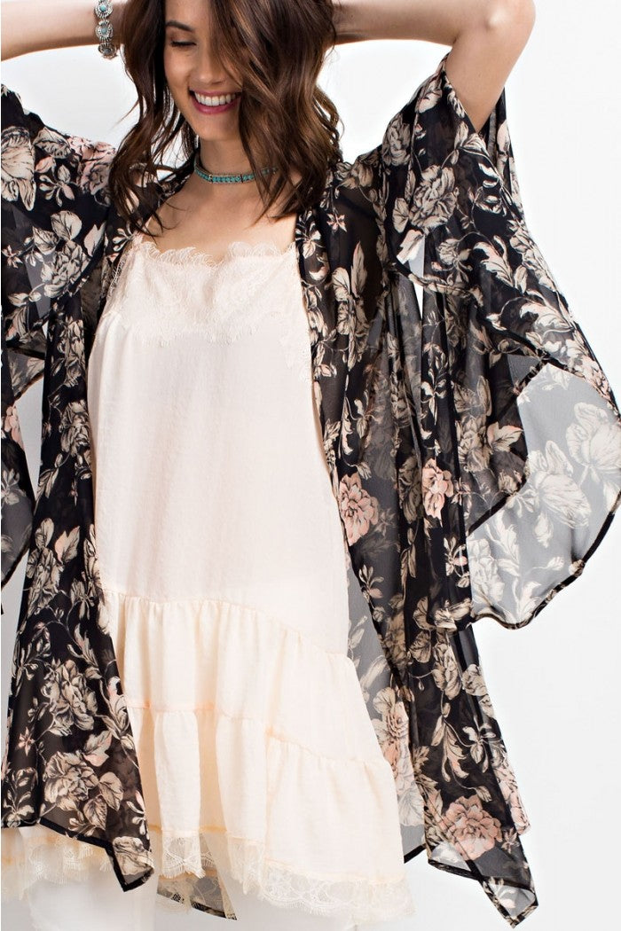 Front view woman wearing black/ivory floral print woven kimono cardigan with bell sleeves - 2