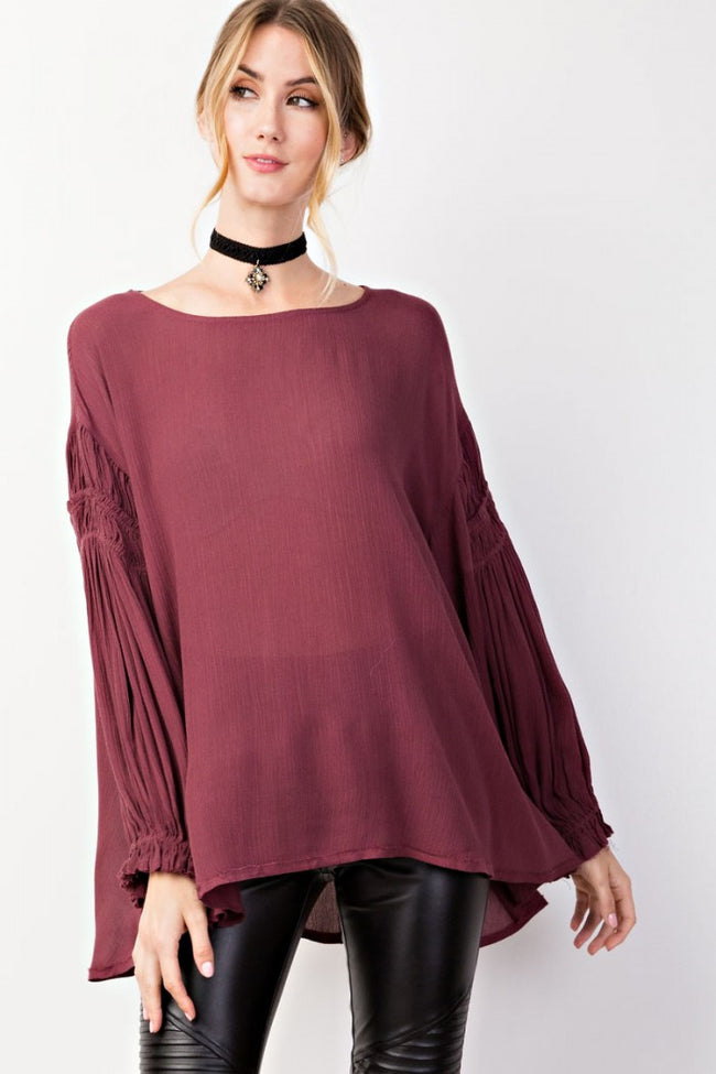 Front view young woman wearing plum ruched sleeve high low tunic top