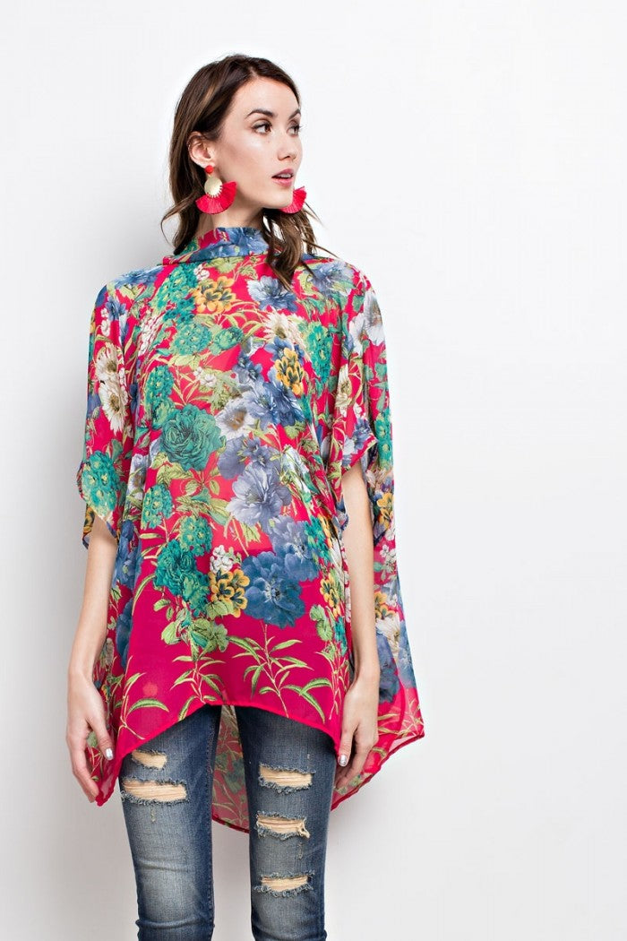 Front view young woman wearing fuchsia floral print poncho-style tunic with tie back - 2
