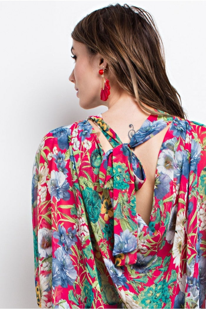 Back detail view fuchsia floral print poncho-style tunic with tie back