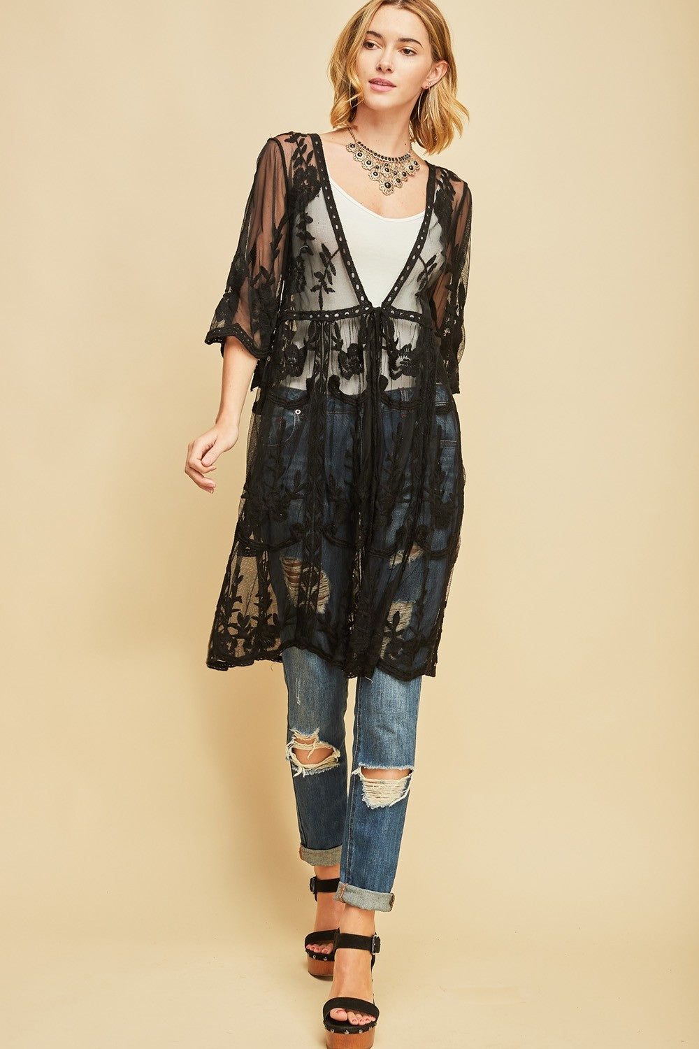 Front full view woman wearing black empire waist tie front sheer floral embroidered kimono