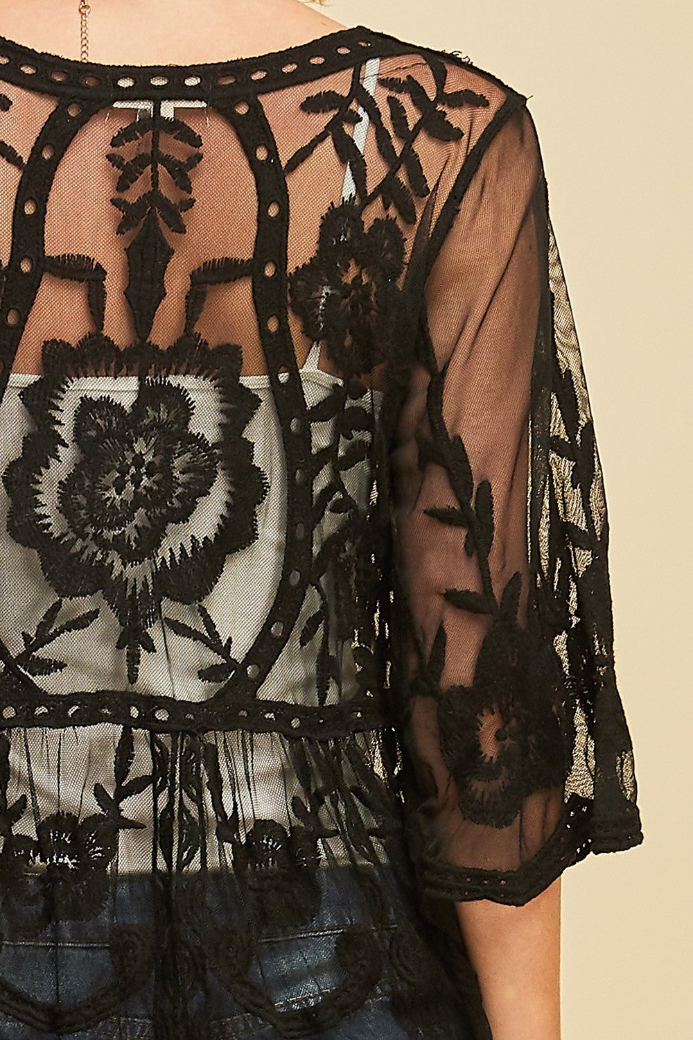 Back detail view woman wearing black empire waist tie front sheer floral embroidered kimono