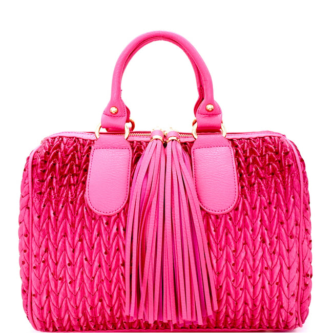 Front view fuchsia quilted satchel handbag with two long tassel accents