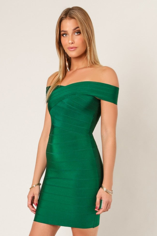 Side view pine green cross bust bodycon bandage dress
