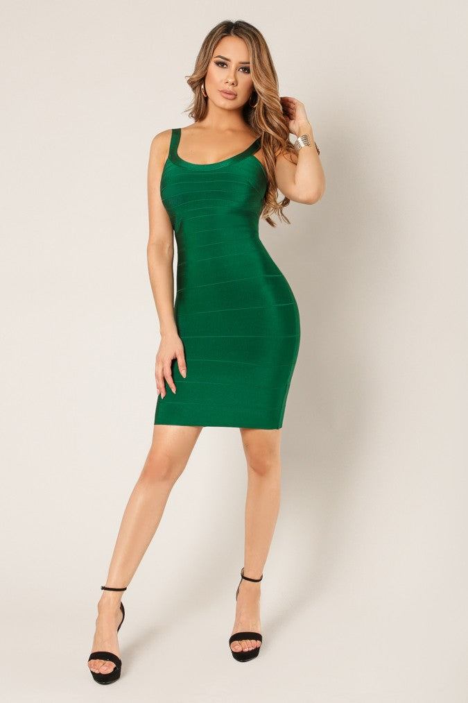 Full front view young woman wearing green bandage sexy club dress