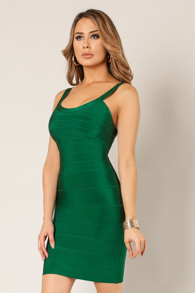 Side view young woman wearing green bandage sexy club dress