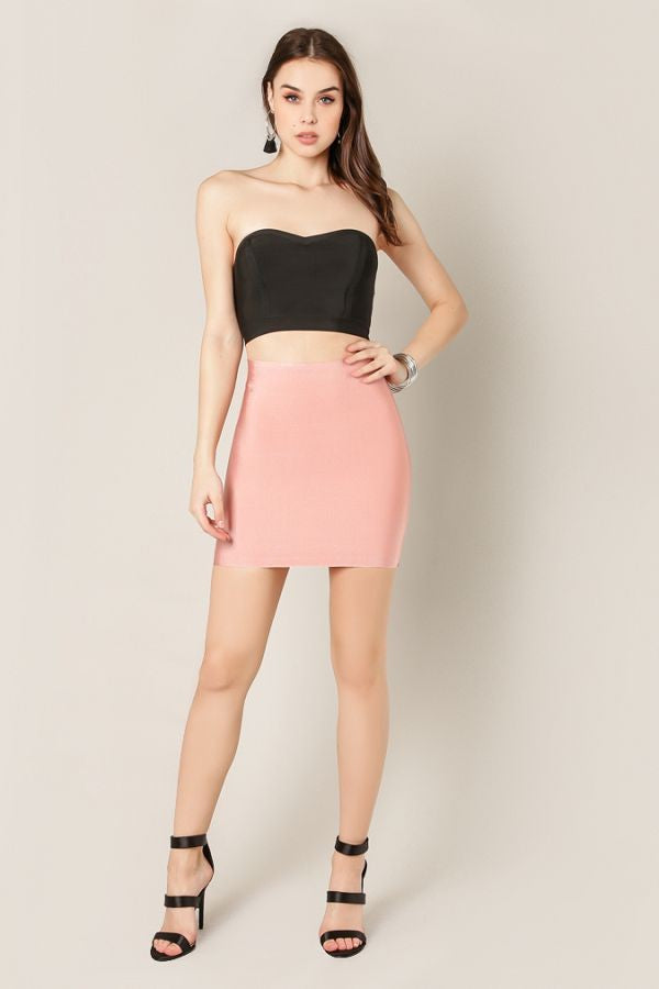 Full front view woman wearing short dusty pink bodycon mini skirt