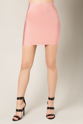 Front view woman wearing short dusty pink bodycon mini skirt