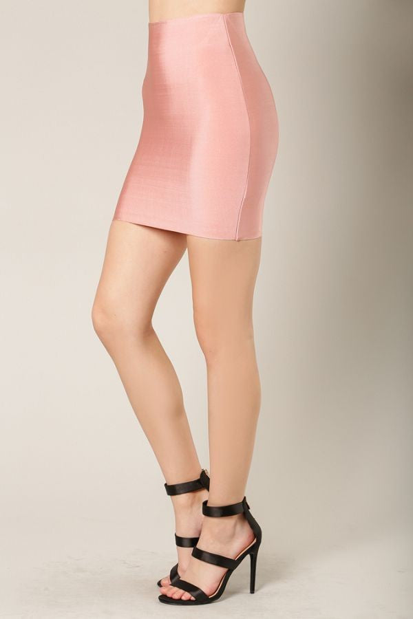 Left side view woman wearing short dusty pink bodycon mini skirt