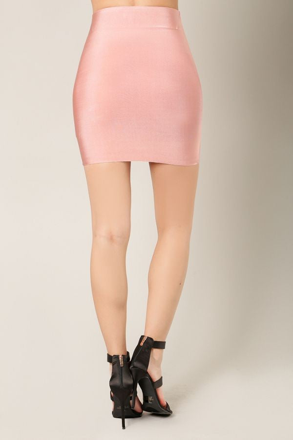 Back view woman wearing short dusty pink bodycon mini skirt