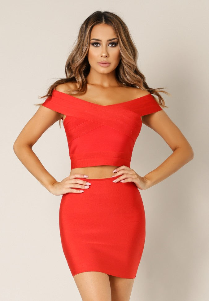 Front view young woman wearing red 2-pc sexy bandage fabric top and skirt