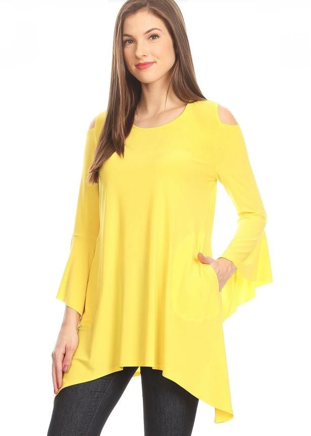 Left side view woman wearing yellow open shoulder bell sleeve tunic top with left hand in pocket