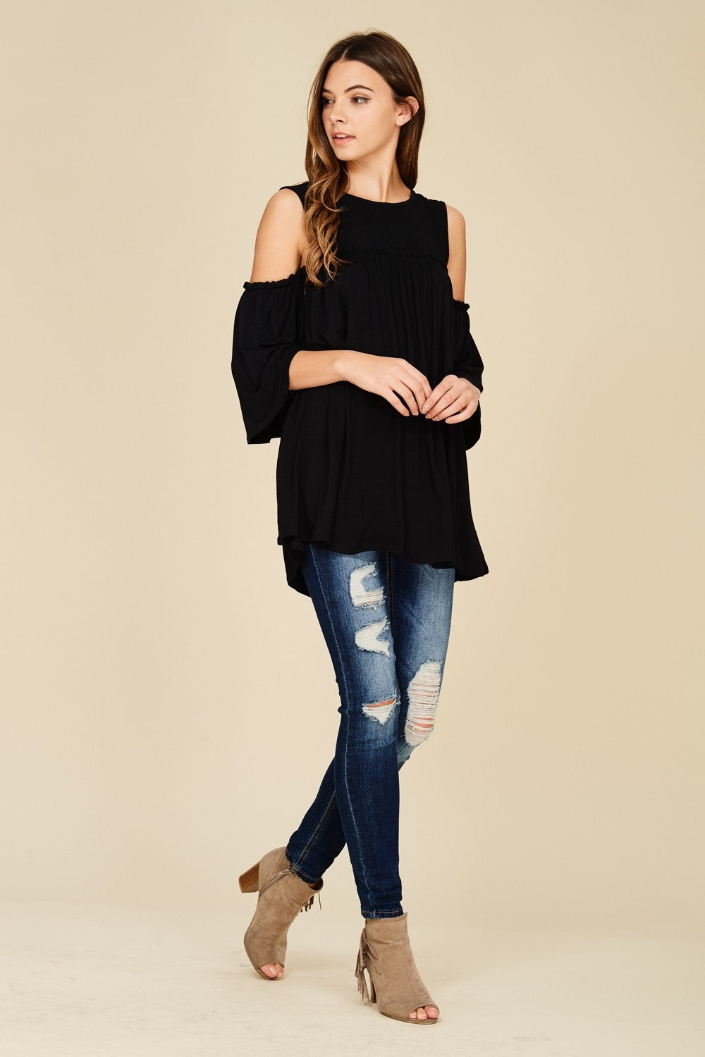Full view black cold shoulder knit tunic top with three quarter bell sleeves
