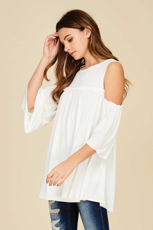 Side View White cold shoulder knit tunic top with three quarter bell sleeves