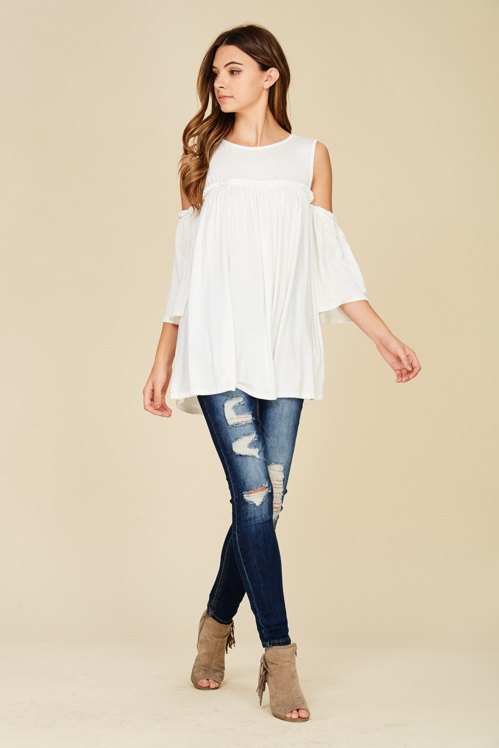 Full view white cold shoulder knit tunic top with three quarter bell sleeves