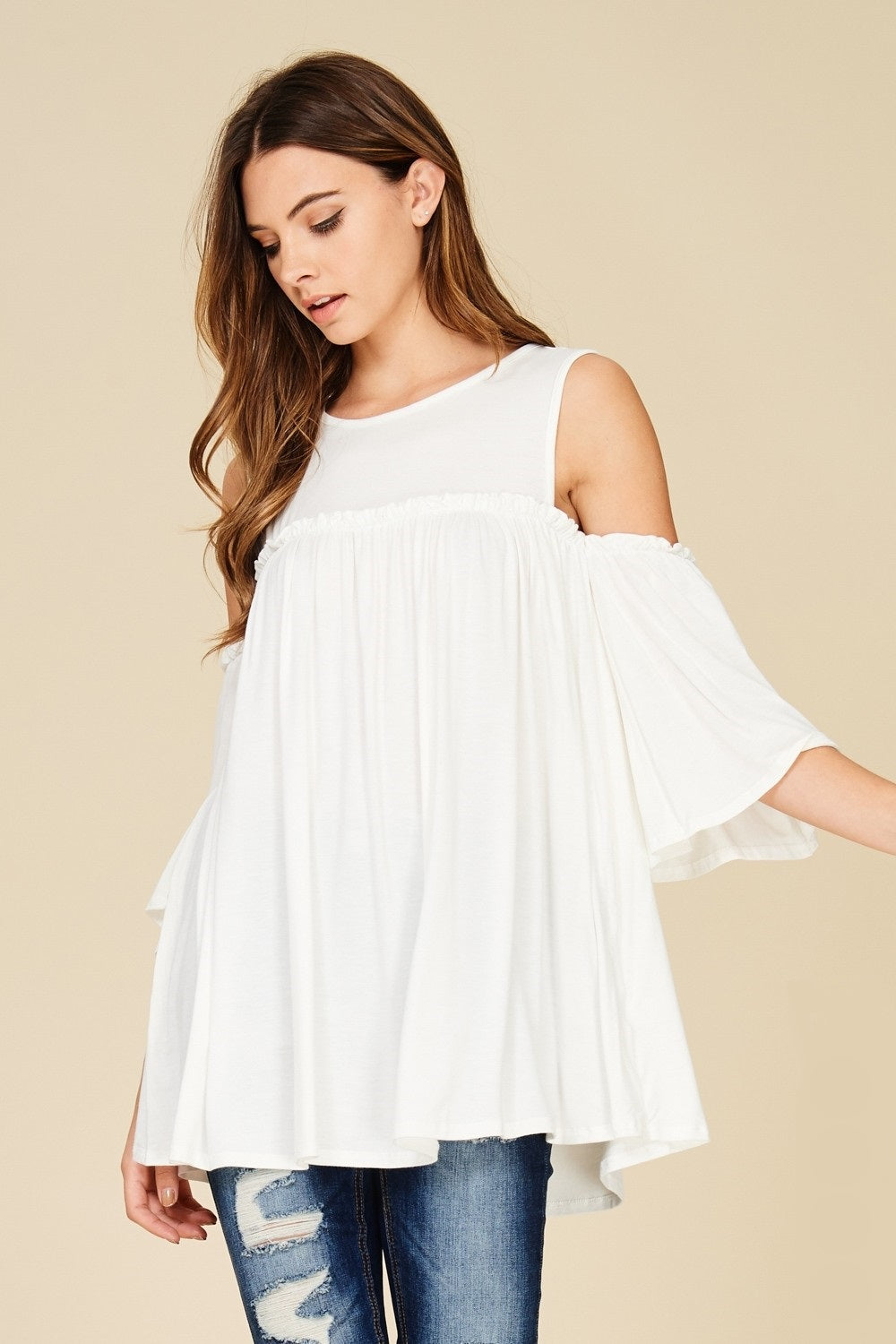 White cold shoulder knit tunic top with three quarter bell sleeves