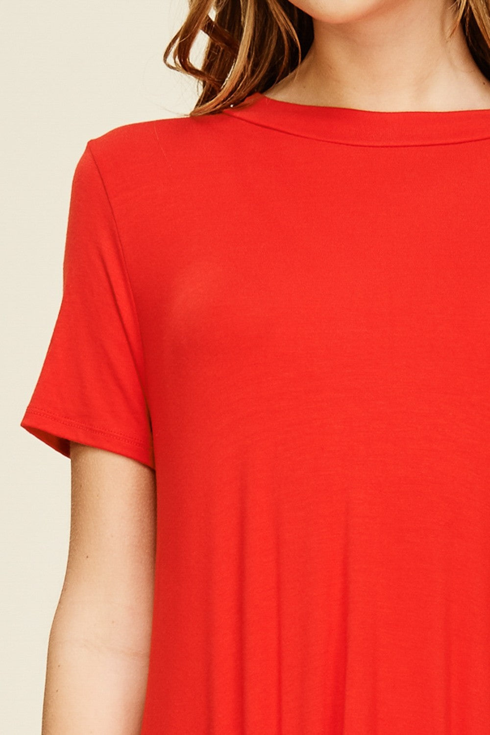 Front detail view poppy red extreme high low short sleeved top