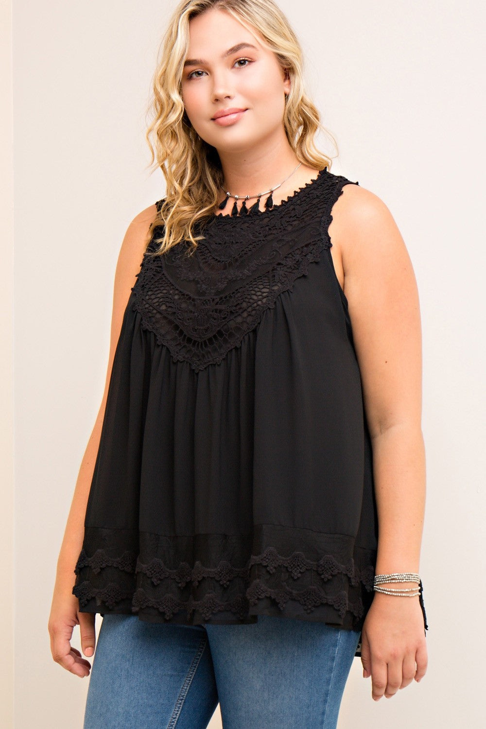 Front view young plus size woman wearing black colored sleeveless crochet trim top - 2
