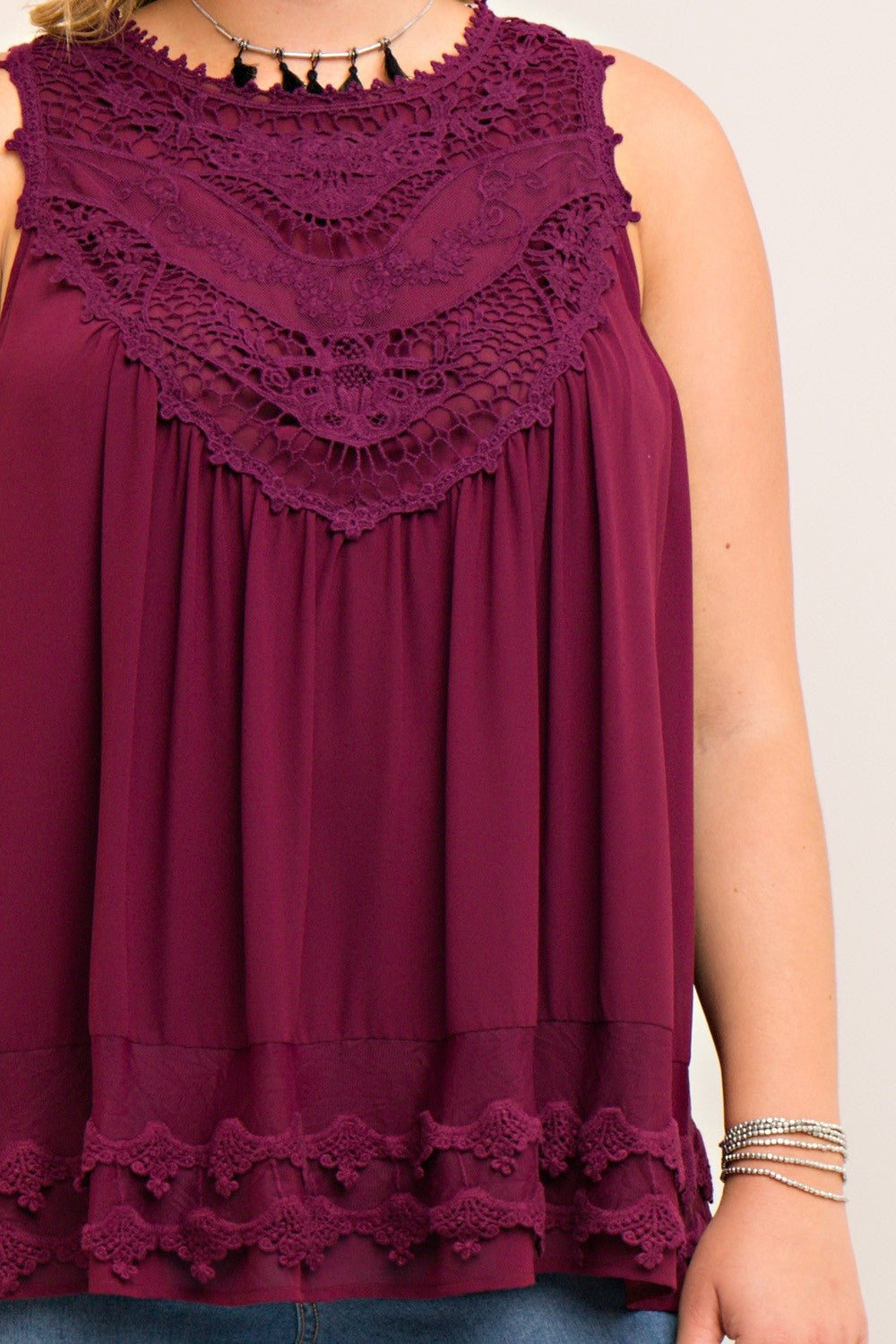 Front detail view wine colored sleeveless crochet trim top