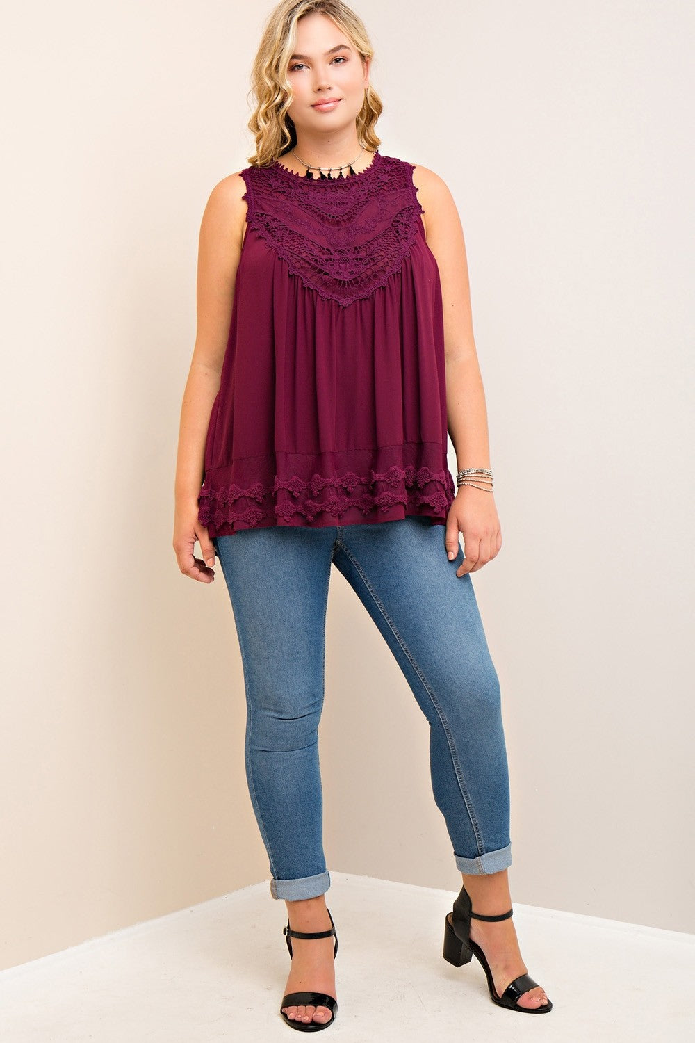 Full front view young plus size woman wearing wine colored sleeveless crochet trim top