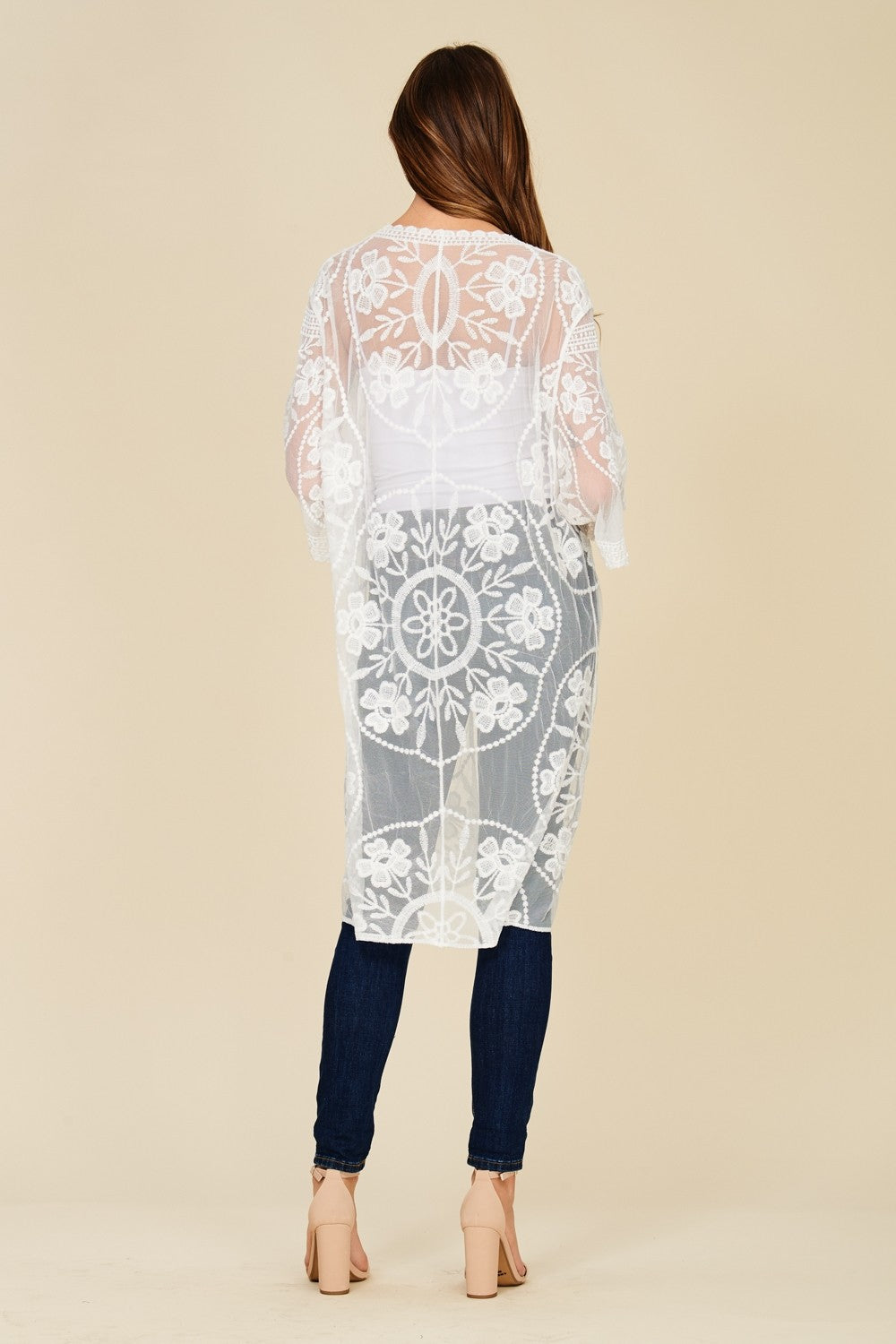 Back full view young woman wearing white sheer mesh cardigan with floral embroidery