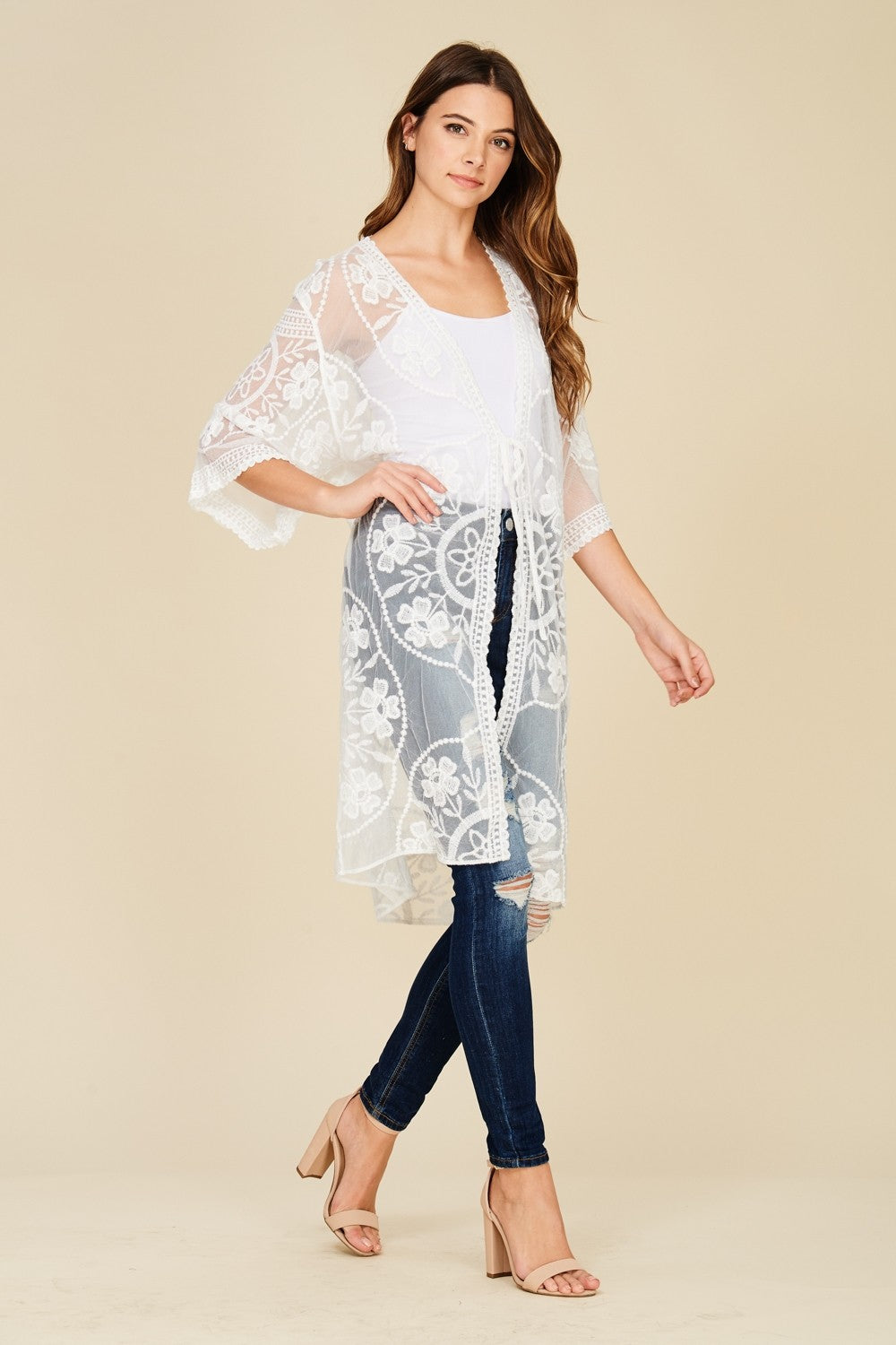 Front/side full view young woman wearing white sheer mesh cardigan with floral embroidery