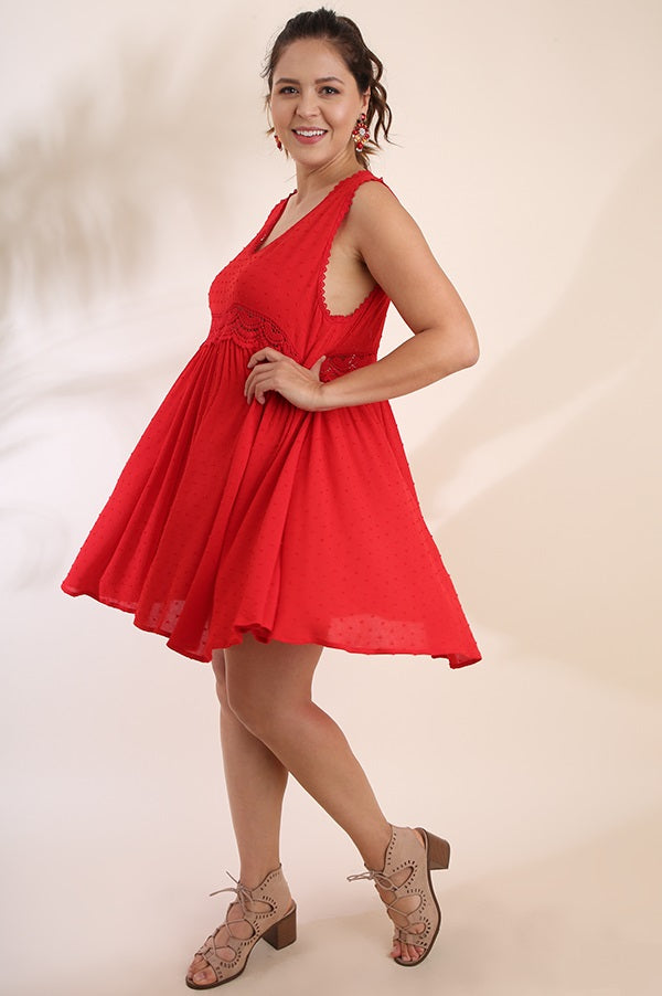 Left side view plus size young woman wearing red sleeveless scoop neck swing dress