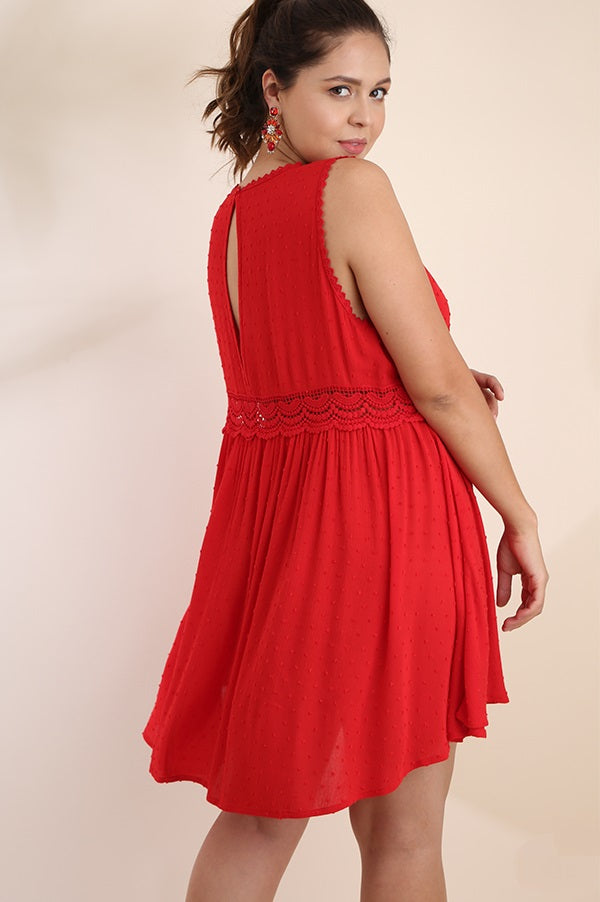 Back view plus size young woman wearing red sleeveless scoop neck swing dress