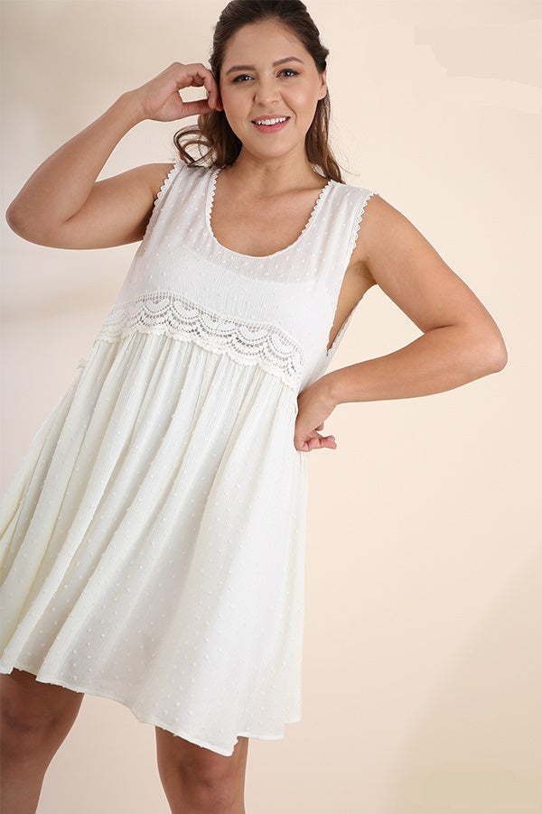 Front view plus size young woman wearing white sleeveless scoop neck swing dress