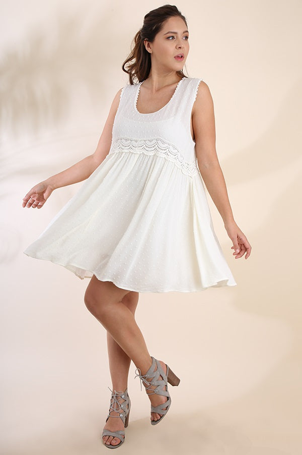 Front full view plus size young woman wearing white sleeveless scoop neck swing dress