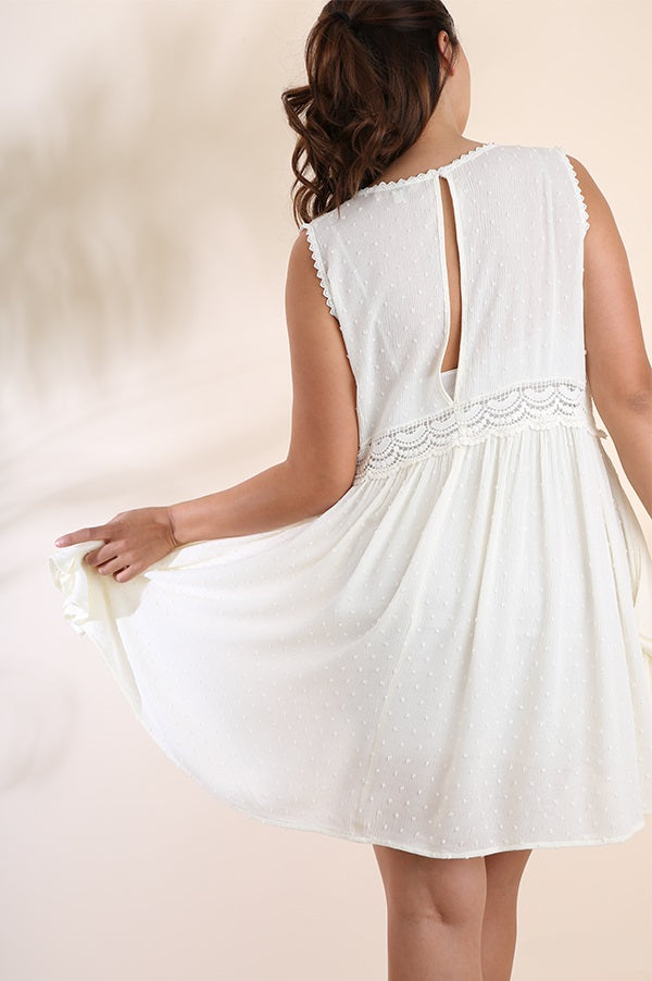 Back view plus size young woman wearing white sleeveless scoop neck swing dress