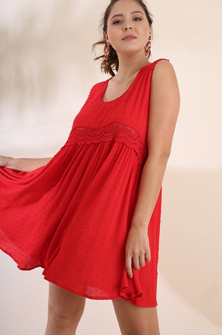 Front view plus size young woman wearing red sleeveless scoop neck swing dress