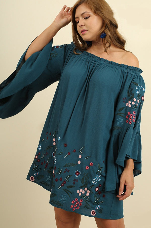 Front view plus size young woman wearing teal floral-embroidered bell sleeve dress