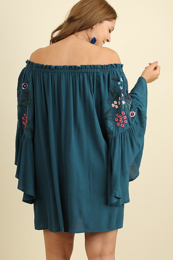 Back view plus size young woman wearing teal floral-embroidered bell sleeve dress