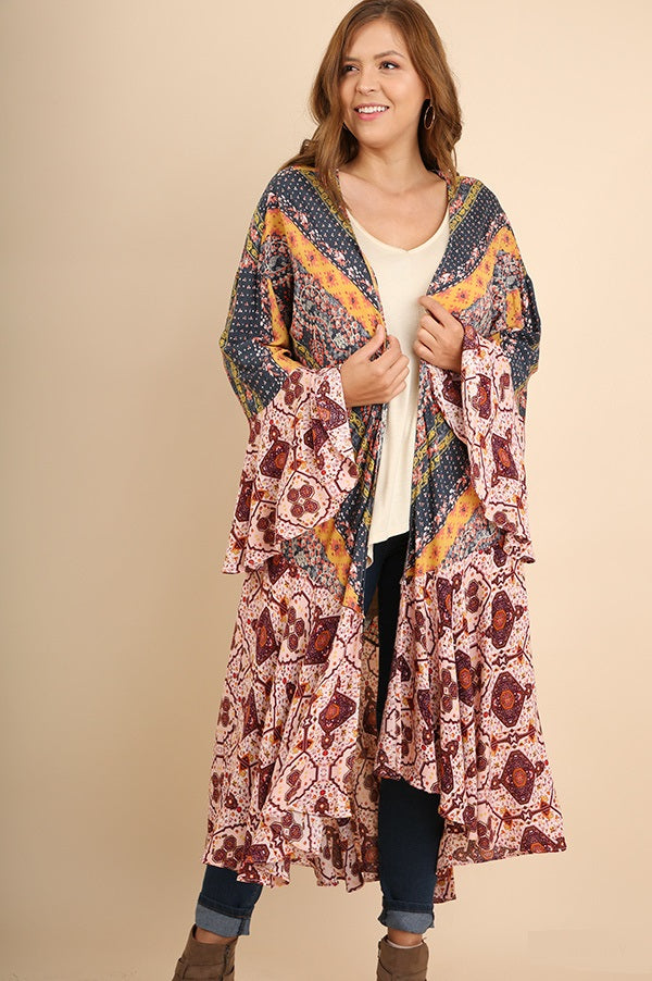 Front view young woman wearing long-length mixed print bell sleeve kimono