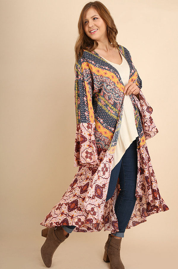 Front right view young woman wearing long-length mixed print bell sleeve kimono