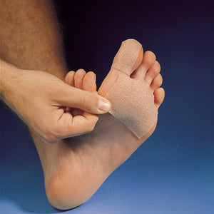 Adhesive knit sheet from the Spenco 2nd skin dressing kit bandages for blister protection applied to the bottom of a foot