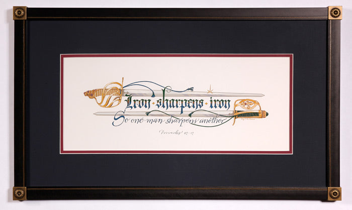 Proverbs 27:17 Iron sharpens iron scripture with swords. Holly Monroe framed calligraphy.