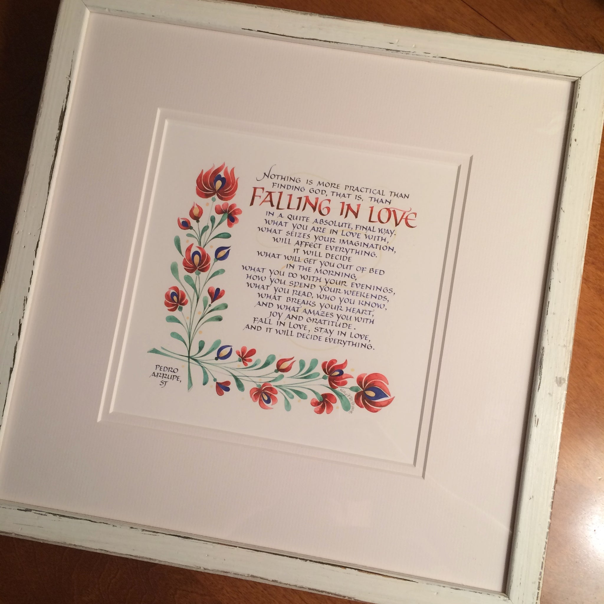 Falling in Love quote by Pedro Arrupe with minimalist white frame. Calligraphy Holly Monroe