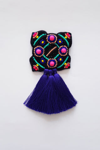 Bright and colorful Ancient brooch with tassels