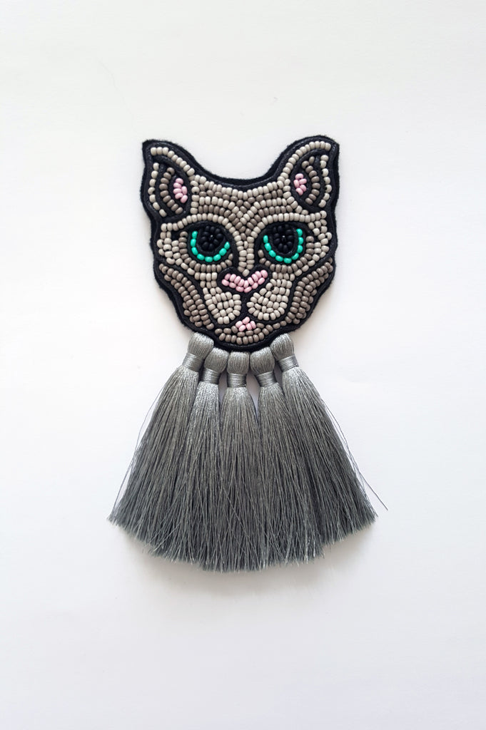 Grey Cat with grey tassels
