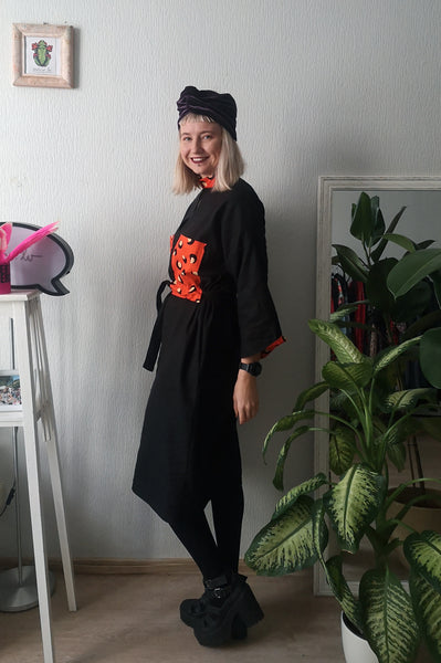 Elegant, Super Cool, Comfortable, Easy to Wear and Versetile Mama Africa Oversized Shirt Dress in Black Linen and Cool Details made from Bright Orange-Red Cotton Fabric directy from Africa