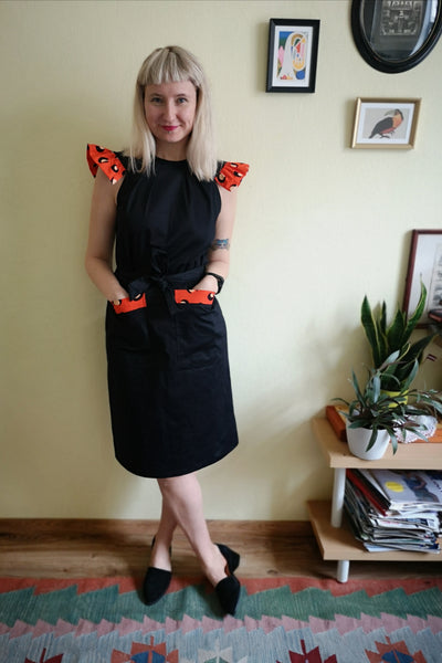 Powerful and Fun Black Cotton Space Princess Aviators Straight Pencil dress with Contrasting Orange-Red Wings