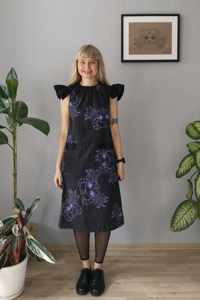 Amelia Earhart Dark Grey Cotton A line dress with oversized butterfly sleeves and Hand printed lavander heroine Lacplesene pattern