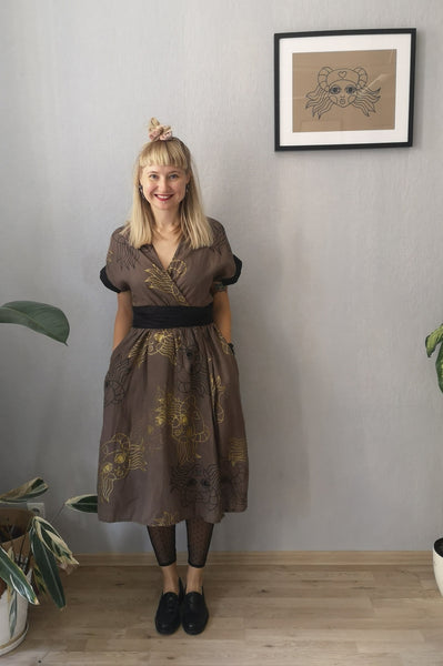 "Kimono Transformer Wrap Dress ""Diane fon Furstenberg""  with Wide Skirt Detail Made from Hand Printed Lāčplēsene Patterned Sand and Gold Colored Linen"