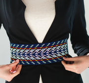 beaded belt with leather ties in blue arrow pattern